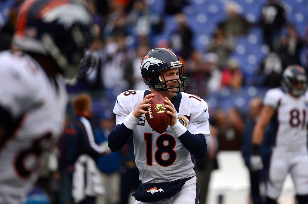 Description of . Denver Broncos quarterback Peyton Manning #18 warming up before the game against the Baltimore Ravens at the M&T Bank Stadium, in Baltimore , MD Sunday December 16, 2012.      Joe Amon, The Denver Post