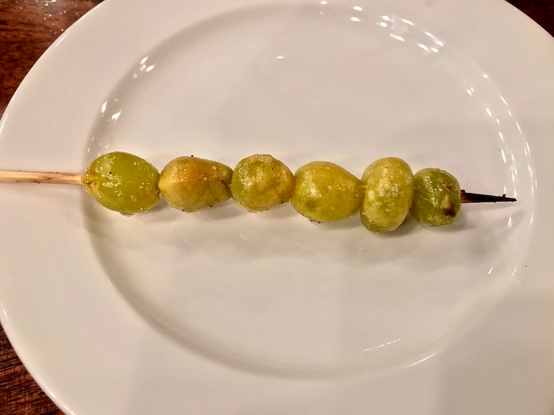 Gingko nuts on a stick.