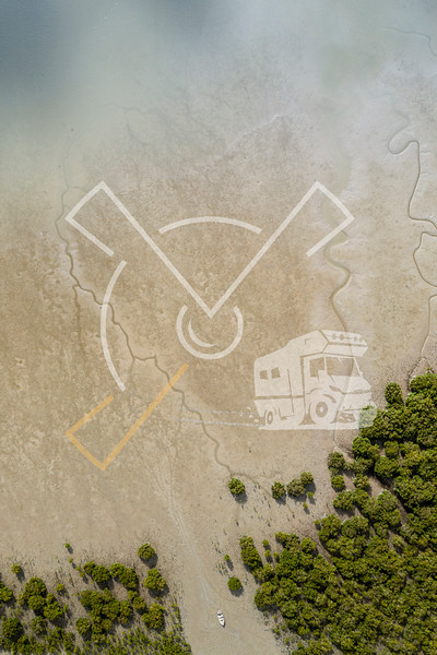 Top view of a shore with a boat during low tide in New Zealand