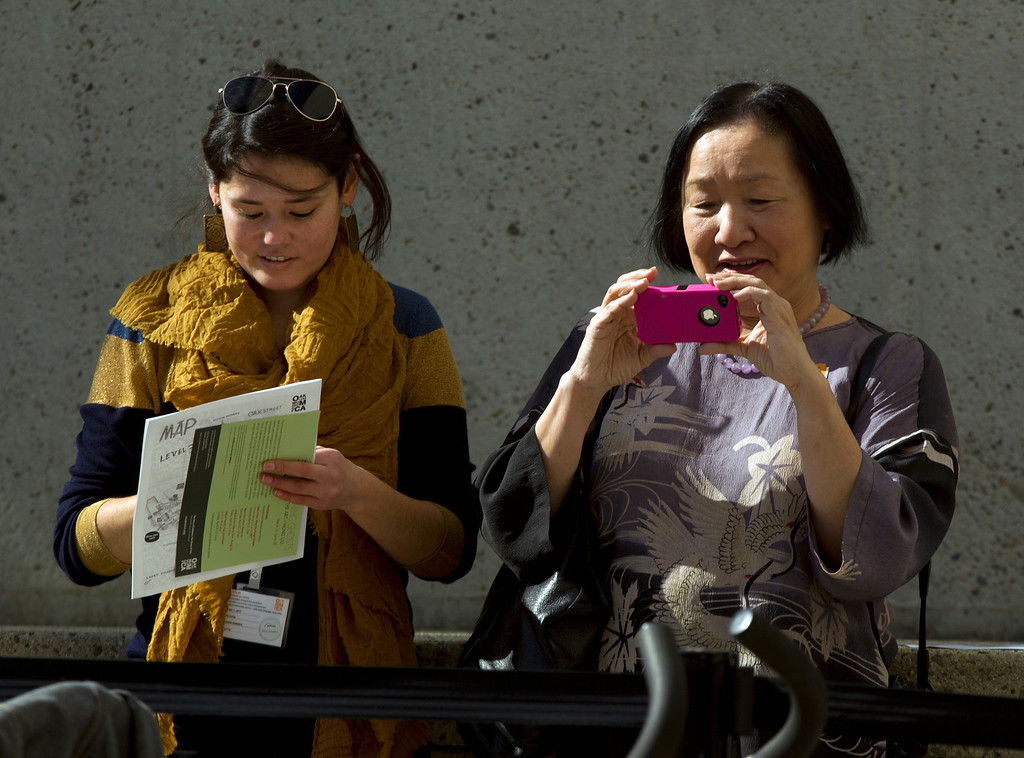 . Claudia Leung, left, marketing and communications coordinator for the Oakland Museum of California, accompanies Oakland, Calif. Mayor Jean Quan during the museum\'s Lunar New Year celebration to mark the Year of the Snake, Sunday, Feb. 17, 2013 in Oakland, Calif. (D. Ross Cameron/Staff)