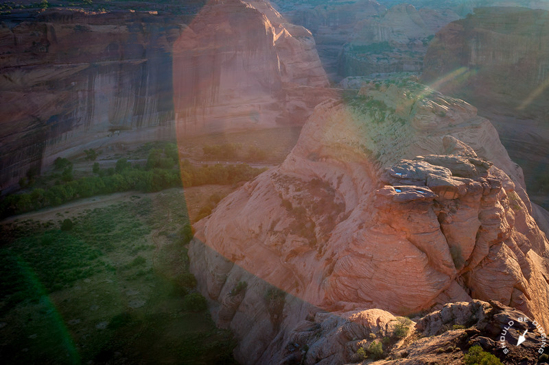 View into Canyon de Chelly in the early morning light with lens flare