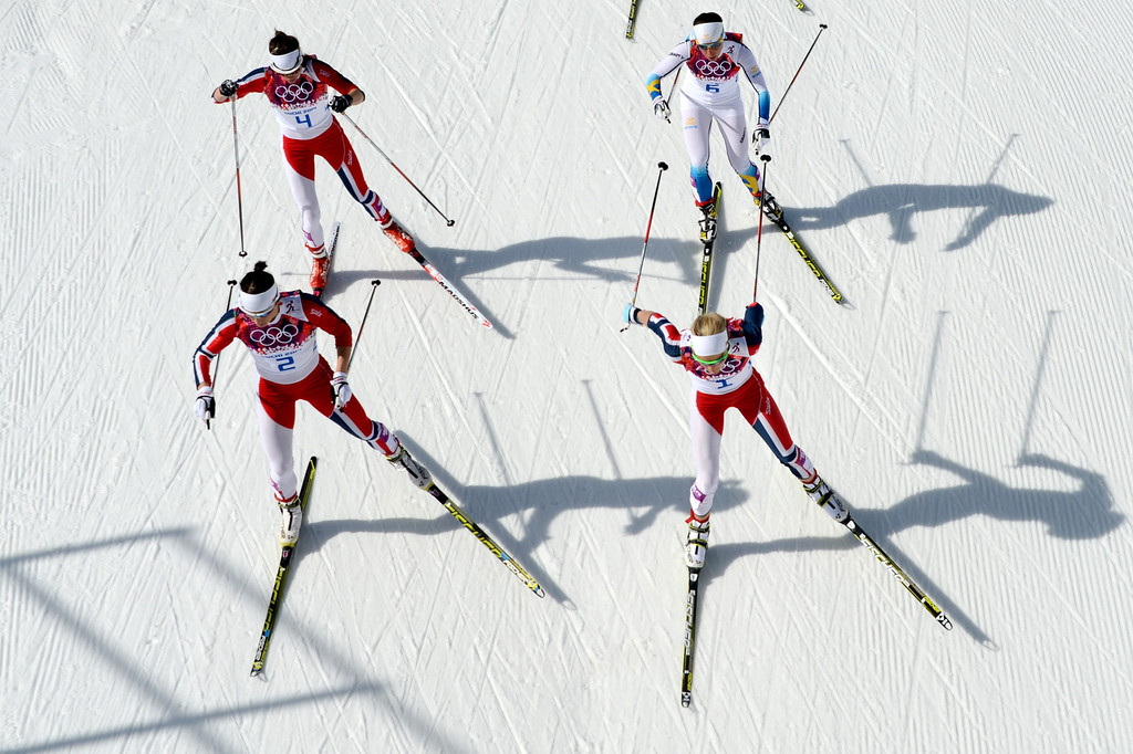 . Norway\'s Marit Bjoergen (front -L) and Norway\'s Therese Johaug (front R) are followed by Norway\'s Heidi Weng (4) and Sweden\'s Charlotte Kalla (6) as they compete in the Women\'s Cross-Country Skiing 30km Mass Start Free at the Laura Cross-Country Ski and Biathlon Center during the Sochi Winter Olympics on February 22, 2014, in Rosa Khutor, near Sochi.  KIRILL KUDRYAVTSEV/AFP/Getty Images