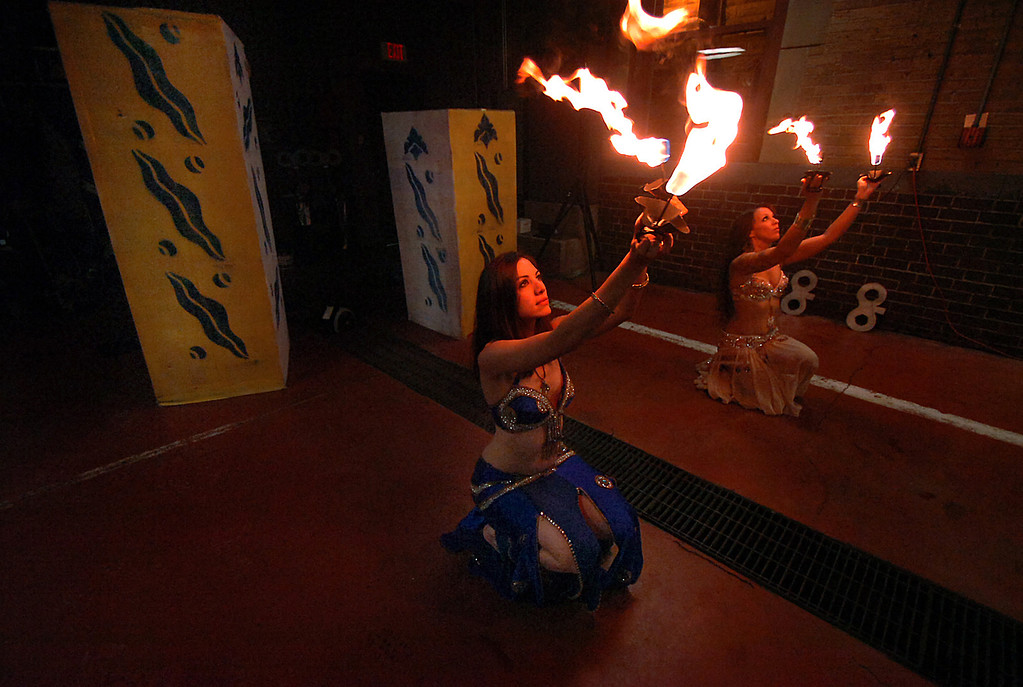 . Lotus Fire Bellydancers from left, Rachel Dare, and Kendra McHugh perform with fire on Monday, Dec. 31, 2012 during the 14th Annual 2013 First Night Scranton New Year\'s Eve festivities in downtown Scranton, Pa. (AP Photo/The Scranton Times-Tribune, Butch Comegys)