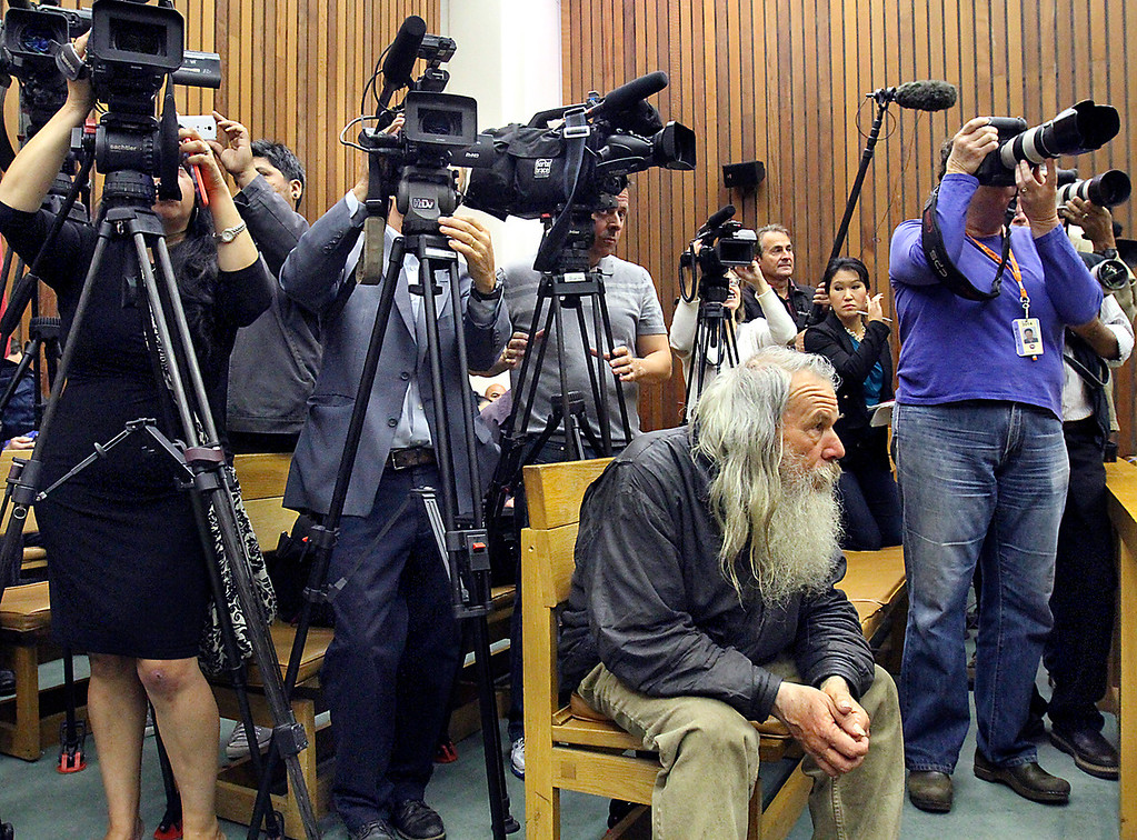 . Courthouse denizen Ray Tucker takes a rather nonplussed attitude as photographers and videographers from around the Monterey Bay, the nation and the world have their cameras trained on Alix Tichelman on Wednesday as she is arraigned for manslaughter for the November 2013 death of Google executive Forrest hayes. (Shmuel Thaler -- Santa Cruz Sentinel)