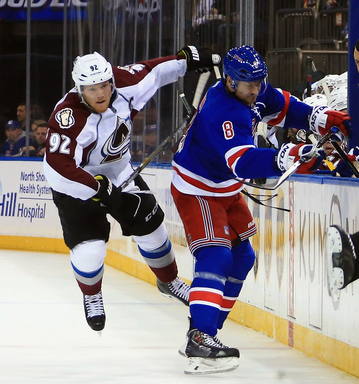 . NEW YORK, NY - NOVEMBER 13: Zach Redmond #22 of the Colorado Avalanche attempts to gte past Kevin Klein #8 of the New York Rangers at Madison Square Garden on November 13, 2014 in New York City. The Avalanche defeated the Rangers 4-3 in the shootout. (Photo by Bruce Bennett/Getty Images)