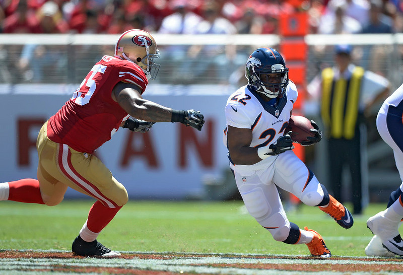 . Denver Broncos running back C.J. Anderson (22) finds a hole as he gets tracked down by San Francisco 49ers outside linebacker Ahmad Brooks (55) during the second quarter  August 17, 2014 at Levi\'s Stadium. (Photo by John Leyba/The Denver Post)