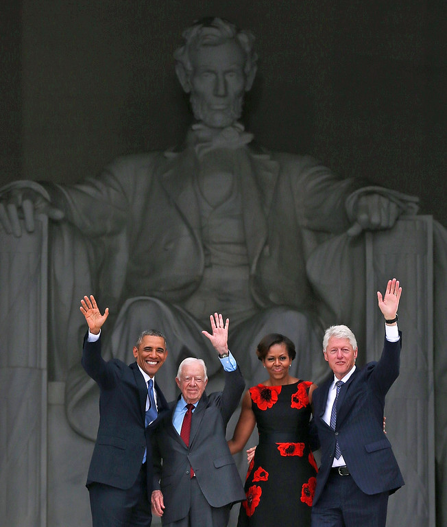 """. President Barack Obama (L) stands with his wife Michelle Obama (2nd-R) and former presidents Jimmy Carter (2nd-L) and Bill Clinton (R) during the ceremony to commemorate the 50th anniversary of the March on Washington for Jobs and Freedom August 28, 2013 in Washington, DC. It was 50 years ago today that Martin Luther King, Jr. delivered his \""""I Have A Dream Speech\"""" on the steps of the Lincoln Memorial. (Photo by Mark Wilson/Getty Images)"""