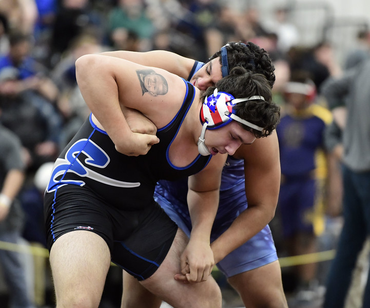 2/16/2019 Mike Orazzi | Staff Bristol Eastern's Trinidad Gonzalez and Fairfield Ludlowe's Stan Godlewski during the CIAC state open wrestling tournament at Bristol Central High School in Bristol Saturday.