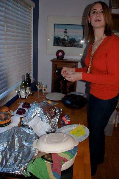 Samantha, Dawn's friend from work, prepares to zest the cranberry sauce.