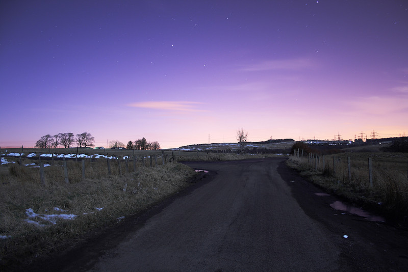Night shot near Brownside Farm which is between Johnstone and Neilston. In the distance is the pylons at Neilston sustation on Glennifer Road which is located within the Glennifer Braes behind Paisley.