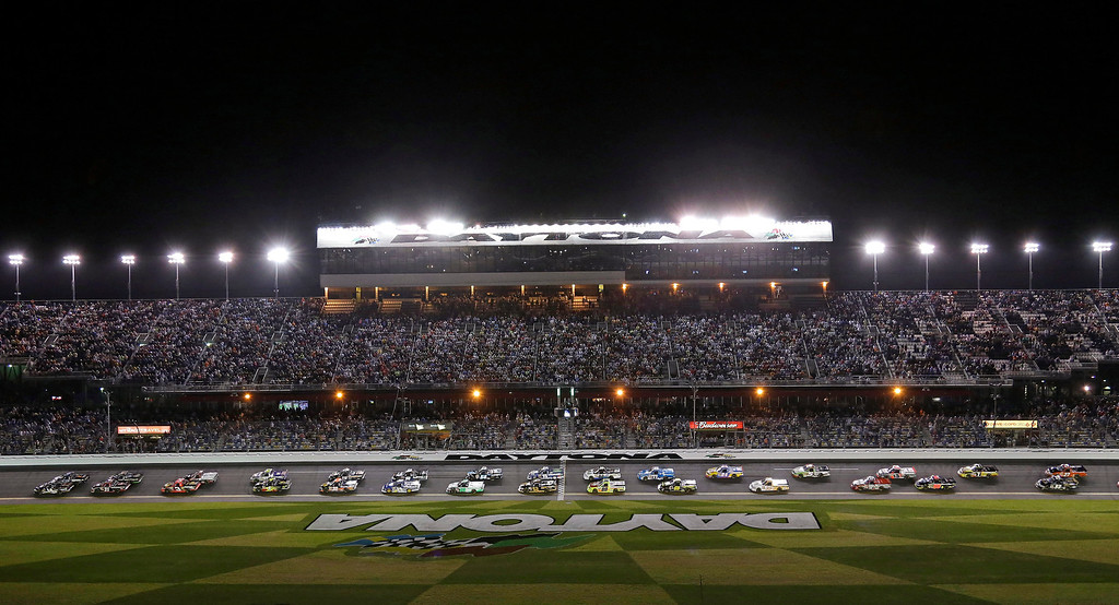 . Pole-sitter Brennan Newberry, far left front, leads a group of trucks past the starting line to begin the NASCAR Truck Series auto race at Daytona International Speedway, Friday, Feb. 22, 2013, in Daytona Beach, Fla. (AP Photo/Chris O\'Meara)