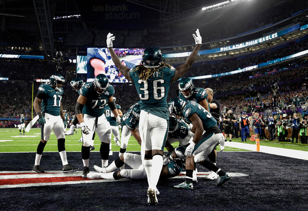 . Philadelphia Eagles\' Jay Ajayi (36), raises his arms after teammate Philadelphia Eagles running back Corey Clement (30) scored a touchdown, during the second half of the NFL Super Bowl 52 football game against the New England Patriots, Sunday, Feb. 4, 2018, in Minneapolis. (AP Photo/Chris O\'Meara)