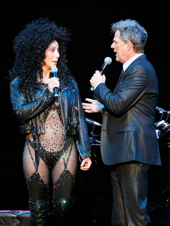 ". LAS VEGAS - MAY 09:  Singer Cher (L) and producer/composer David Foster appear during the ""Hit Man: David Foster and Friends\"" concert at the Mandalay Bay Events Center May 9, 2009 in Las Vegas, Nevada.  (Photo by Ethan Miller/Getty Images)"