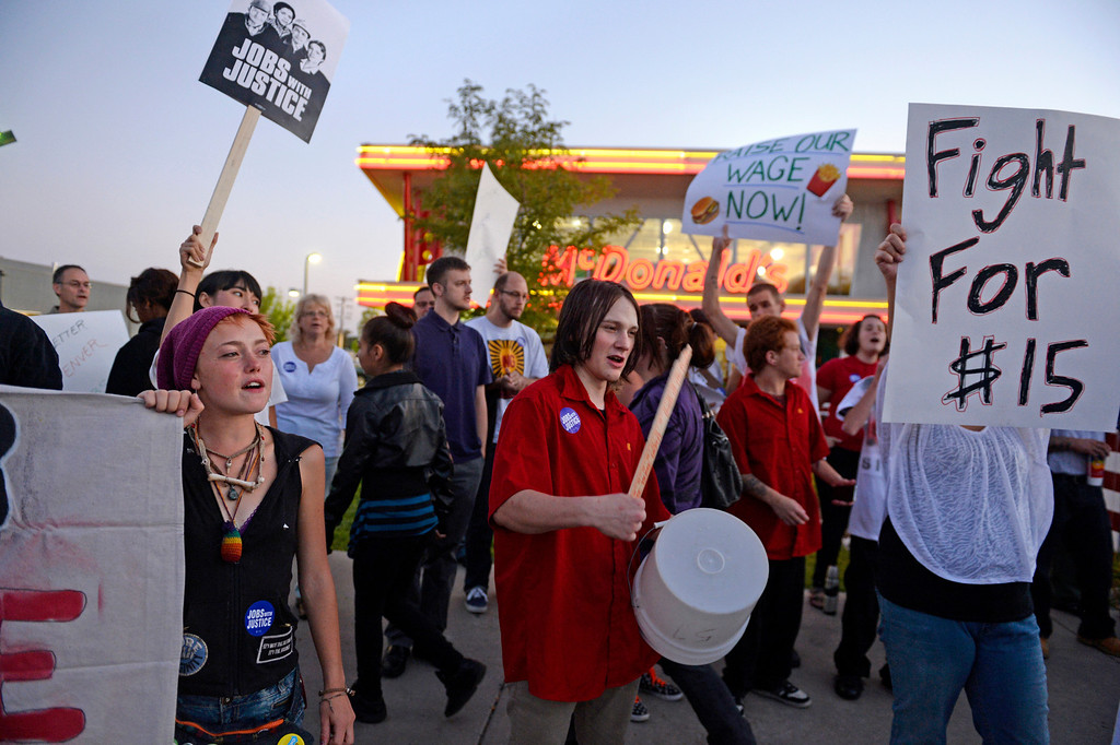 . NORTHGLENN, CO-August, 2013: Protesters asking for better wages for fast food workers stand outside a McDonald\'s in Northglenn, August 29, 2013. The asking rate is $15 an hour for workers in this nationally organized event. (Photo By RJ Sangosti/The Denver Post)