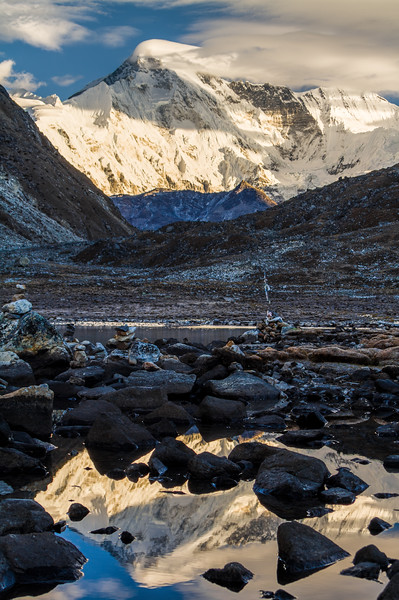Cho Oyu reflected in the shore of Gokyo Lake in Gokyo, Nepal