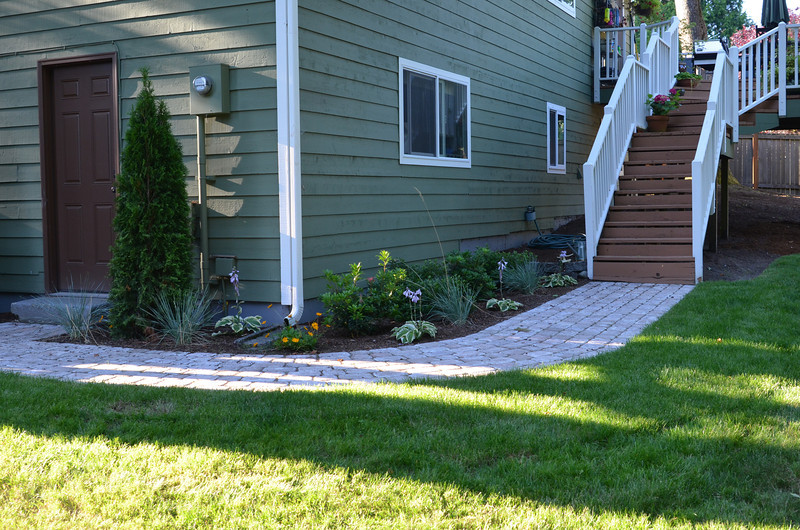 Professionally installed paver walkway and landscaping.