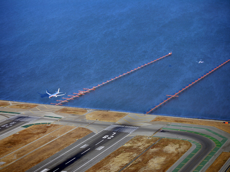 Two planes coming in for a landing below us at SFO.