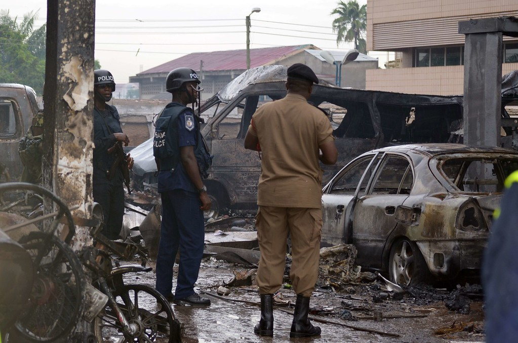 . Policemen look at burnt vehicles at the scene where at least 90 people were killed in a petrol station fire in Ghana\'s capital, Accra, on June 4, 2015. The fire broke out at the filling station in the Kwame Nkrumah Circle area of the city late on Wednesday night and is thought to have spread from a nearby residence. AFP PHOTO / FATI BRAIMAH/AFP/Getty Images