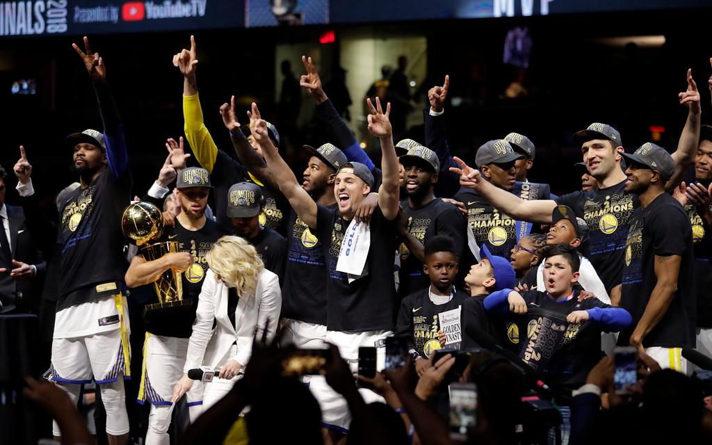 . The Golden State Warriors celebrate after defeating the Cleveland Cavaliers 108-85 in Game 4 of basketball\'s NBA Finals to win the NBA championship, Friday, June 8, 2018, in Cleveland. (AP Photo/Tony Dejak)