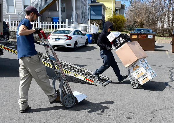 4/2/2020 Mike Orazzi | Staff Napoli Foods' Jacob Dube and Angel Santana deliver food to West End Pizza in Bristol on Thursday.