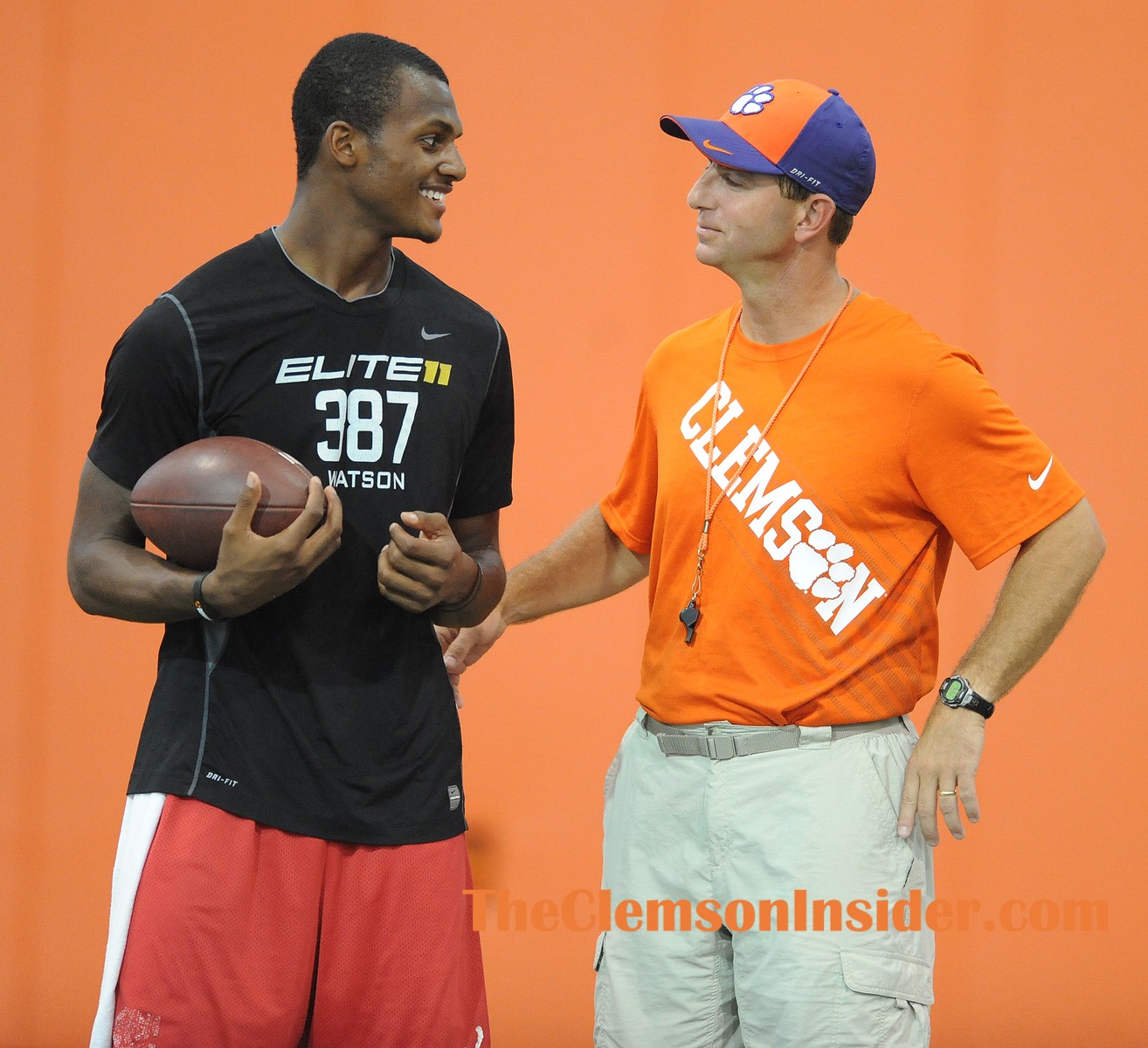 Clemson head coach Dabo Swinney talks with QB DeShaun Watson during Swinney's football camp Wednesday, June 12, 2013.
