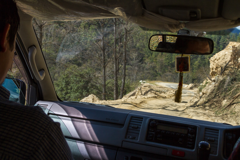 Road under construction in the mountains of futon as seen from inside a car