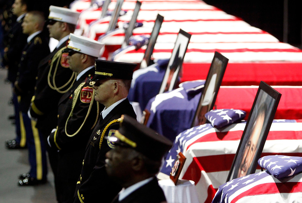 . An honor guard of firefighters stand before the coffins of fallen firefighters before a memorial service for the victims of the West, Texas fertilizer plant explosion last week, at Baylor University in Waco, Texas, April 25, 2013.  REUTERS/Richard Rodriguez