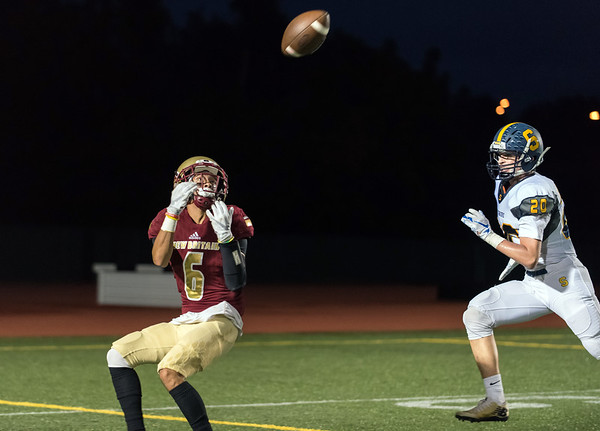 09/28/18 Wesley Bunnell | Staff New Britain football vs Simsbury on Friday night at Veterans Stadium. Chris Maldonado (6) with a reception deep in Simbsbury territory.