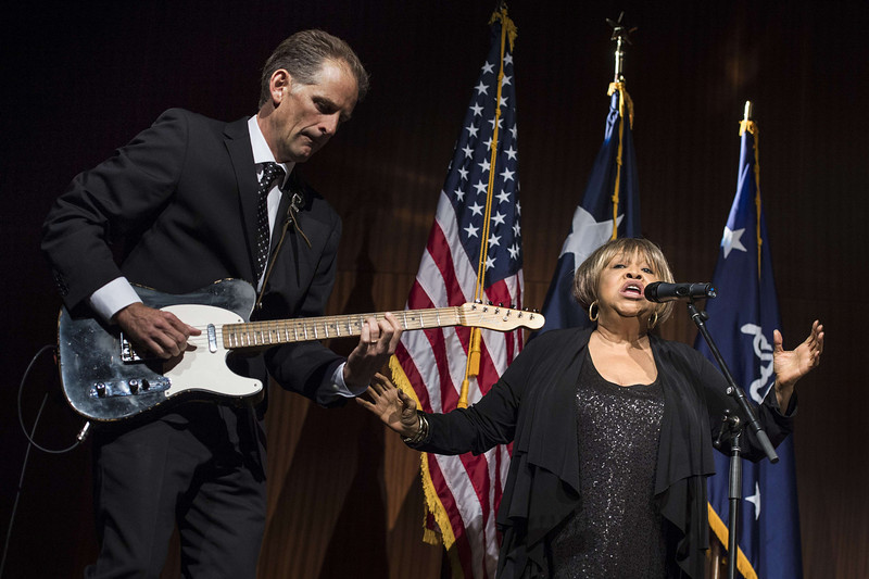 ". Mavis Staples sings ""We Shall Overcome\"" at the Lyndon B. Johnson Presidential Library April 10, 2014 in Austin, Texas. US President Barack Obama is attending the civil rights summit to celebrate the 50th anniversary of the Civil Rights Act of 1964. (BRENDAN SMIALOWSKI/AFP/Getty Images)"