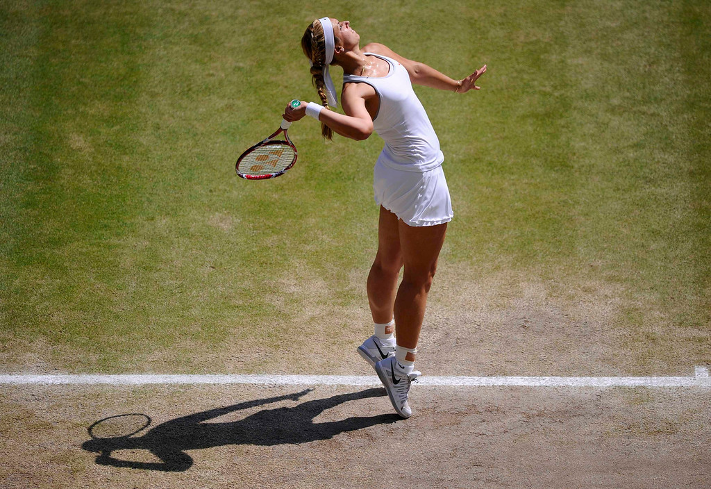 . Sabine Lisicki of Germany serves to Marion Bartoli of France during their women\'s singles final tennis match at the Wimbledon Tennis Championships, in London July 6, 2013.          REUTERS/Adrian Dennis/Pool