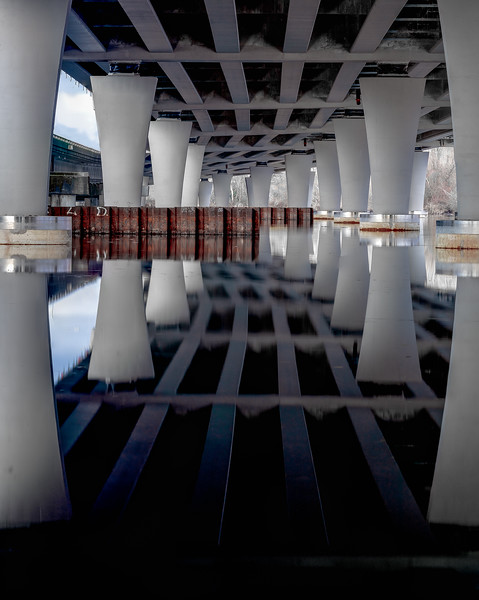 Reflections under a bridge