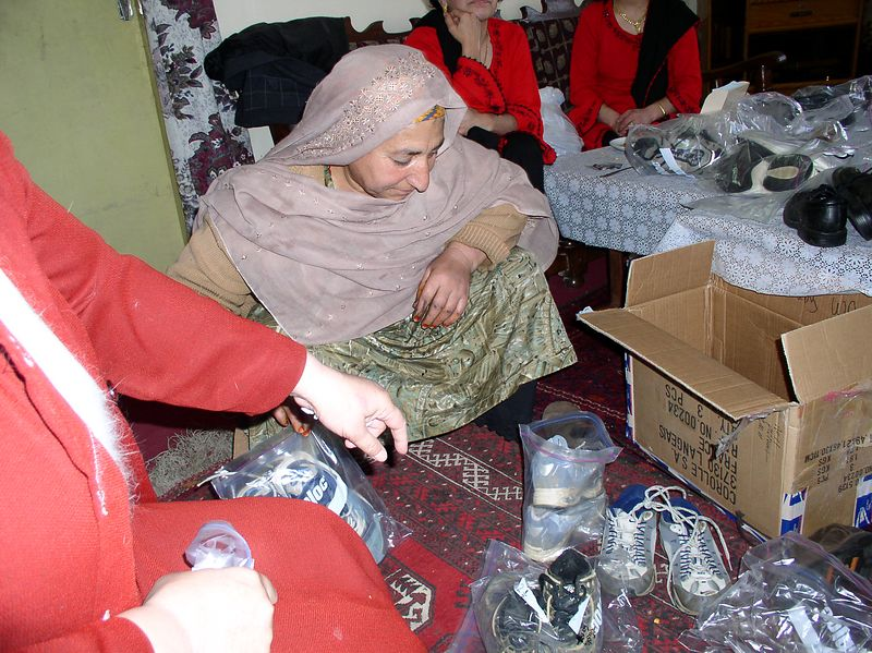 This widowed mother was selecting shoes for her children.