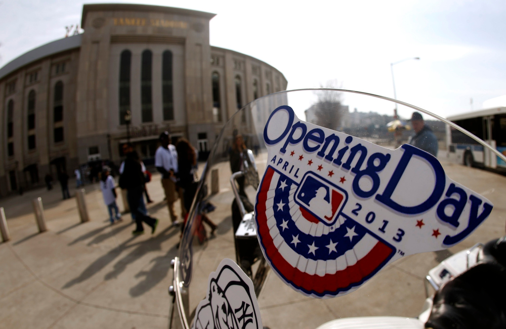 ". An ""Opening Day\"" sticker is seen on the windshield of a motorcycle outside Yankee Stadium before the New York Yankees opening day MLB American League baseball game against the Boston Red Sox in New York, April 1, 2013.  REUTERS/Mike Segar"
