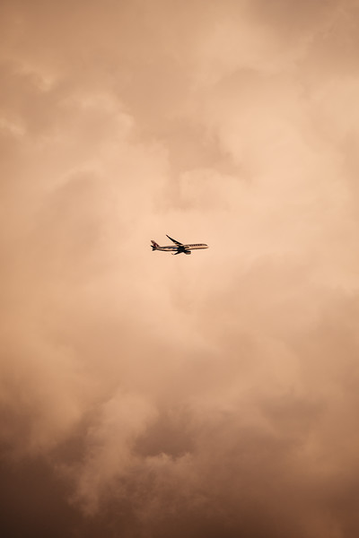 Qatar airways plane flying in front of the clouds in London