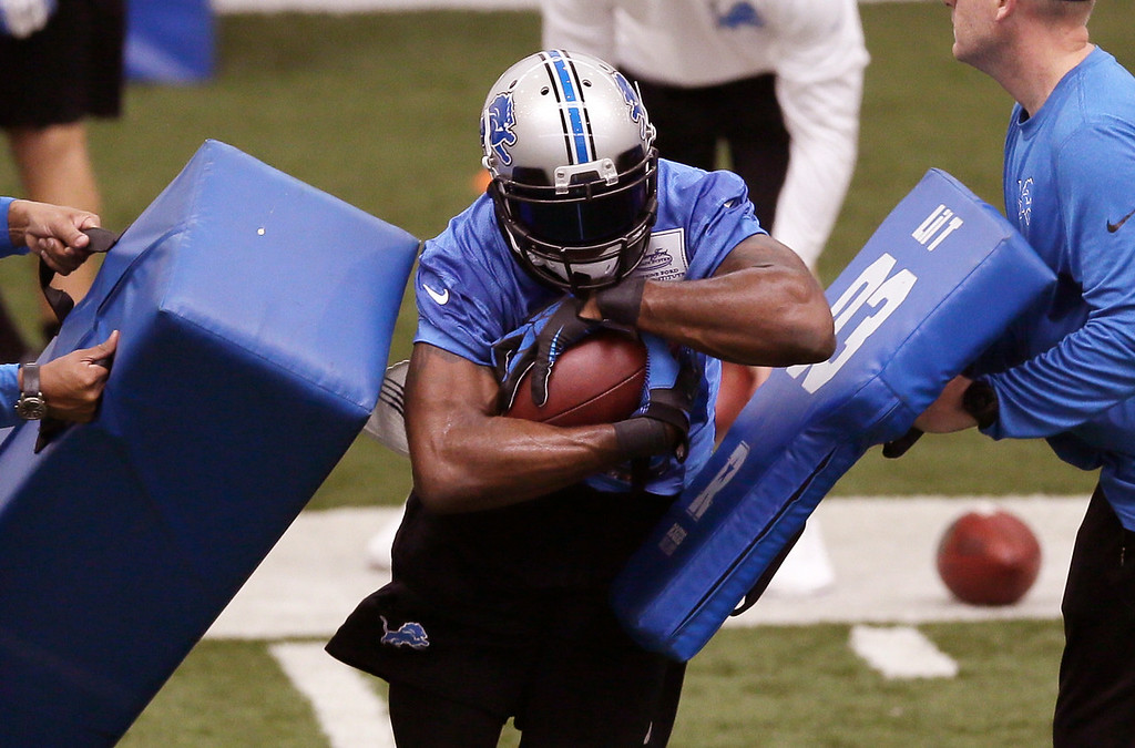 . Detroit Lions wide receiver Calvin Johnson runs through drills during organized team activities at the Lions training camp facility in Allen Park, Mich., Wednesday, May 21, 2014. (AP Photo/Carlos Osorio)