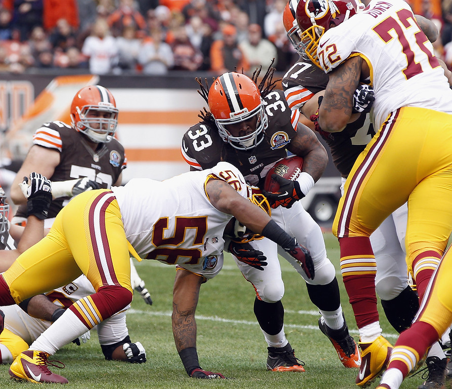 . Running back Trent Richardson #33 of the Cleveland Browns scores a touchdown as he is hit by linebacker Perry Riley #56 and defensive lineman Stephen Bowen #72 of the Washington Redskins at Cleveland Browns Stadium on December 16, 2012 in Cleveland, Ohio.  (Photo by Matt Sullivan/Getty Images)
