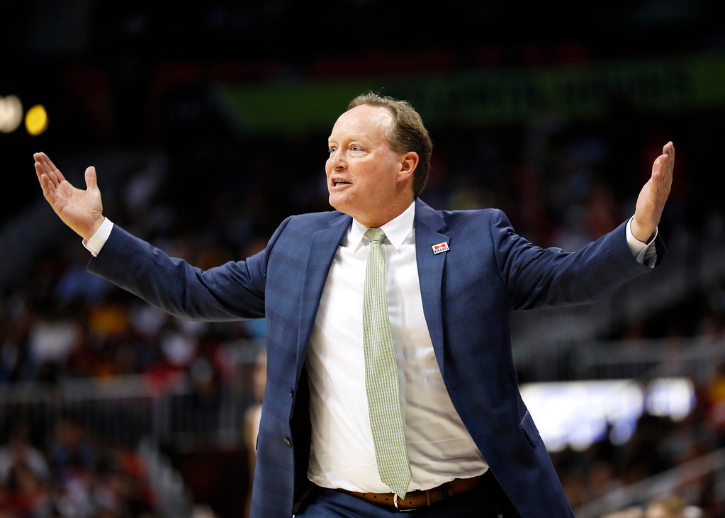 . Atlanta Hawks head coach Mike Budenholzer reacts in the second half of an NBA basketball game between the Cleveland Cavaliers and Atlanta Hawks on Sunday, April 9, 2017, in Atlanta. The Hawks won in overtime 126-125. (AP Photo/Todd Kirkland)