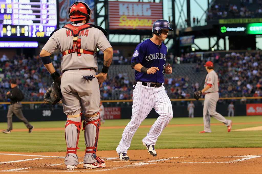 . Corey Dickerson #6 of the Colorado Rockies scores on a double by Troy Tulowitzki #2 of the Colorado Rockies off of starting pitcher Lance Lynn #31 of the St. Louis Cardinals to give the Rockies a 1-0 lead in the first inning at Coors Field on September 16, 2013 in Denver, Colorado.  (Photo by Doug Pensinger/Getty Images)