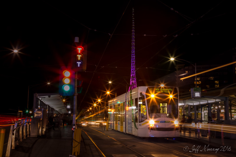 A Tram pulls away from Flinder's Street Station towards Melbourne University.