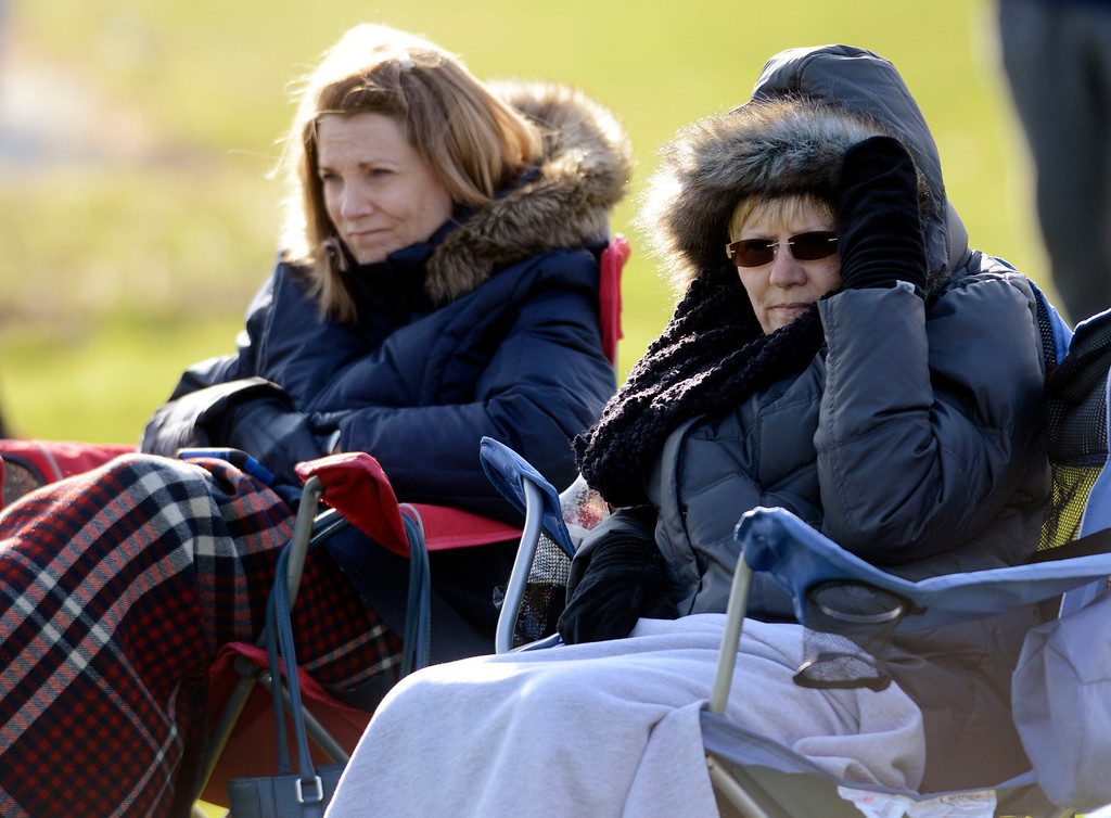 . Maribeth Joeright/MJoeright@News-Herald.com<p> Jill Snyder, left, and Denise Clark of Russell Township bundle up to stay warm as they watch their sons Tim Snyder and Ross Clark play baseball against Kenston at West Geauga High School, April 22, 2014. Temperatures in the upper 40\'s and a prevailing wind from the north made watching the game a not so pleasant experience.