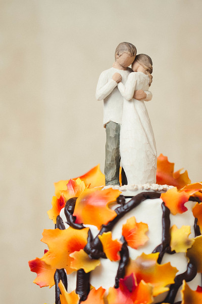 cake topper on fall themed wedding cake