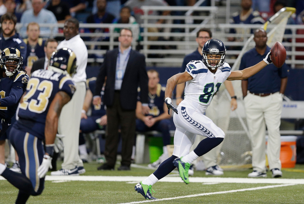 . Seattle Seahawks wide receiver Golden Tate (81) runs to the end zone for a touchdown during the second half of an NFL football game against the St. Louis Rams, Monday, Oct. 28, 2013, in St. Louis. (AP Photo/Michael Conroy)