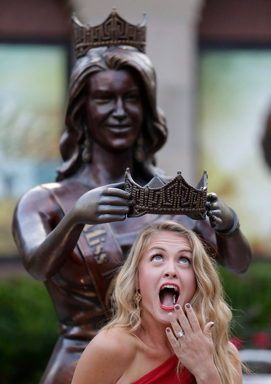 . Amanda Garvin, 31, of Morgantown, W.V., poses for a photograph before the start of the Miss America 2015 pageant, Sunday, Sept. 14, 2014, in Atlantic City, N.J. Garvin\'s sister, Paige Madden, is representing West Virginia during the pageant. (AP Photo/Julio Cortez)