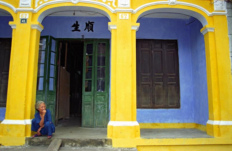 Woman Outside Yellow House, Hoi An