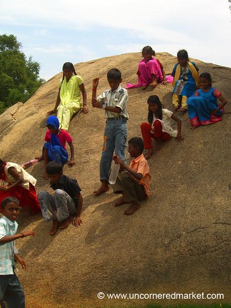 Kids on Krishna's Butter Ball - Mamallapuram