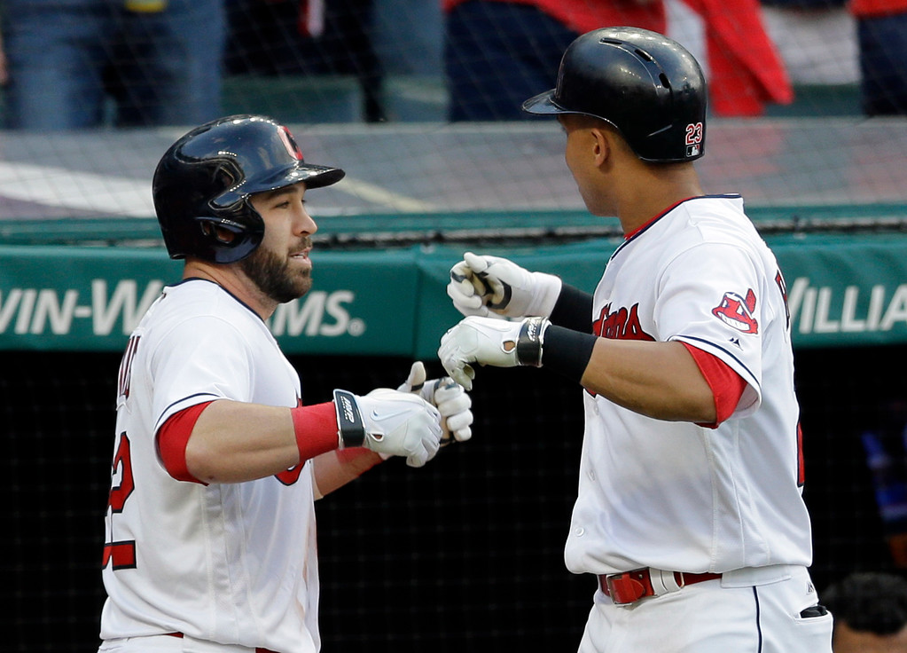 . Cleveland Indians\' Jason Kipnis, left, celebrates with Michael Brantley after Kipnis hit a solo home run off Oakland Athletics starting pitcher Sonny Gray in the fifth inning of a baseball game, Tuesday, May 30, 2017, in Cleveland. (AP Photo/Tony Dejak)