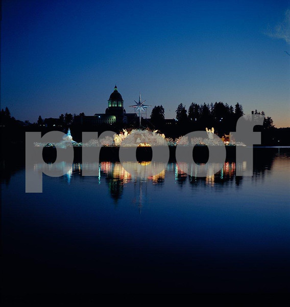Christmas Island floating on Capitol Lake in 1978 with the Capitol building in the background.