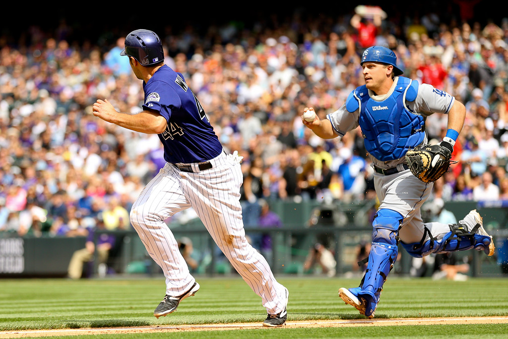 . DENVER, CO - JUNE 7:  Catcher Tim Federowicz #26 of the Los Angeles Dodgers runs down Ryan Wheeler #44 of the Colorado Rockies for the first out of the fifth inning at Coors Field on June 7, 2014 in Denver, Colorado. The Rockies defeated the Dodgers 5-4 in 10 innings to end their eight game losing streak. (Photo by Justin Edmonds/Getty Images)