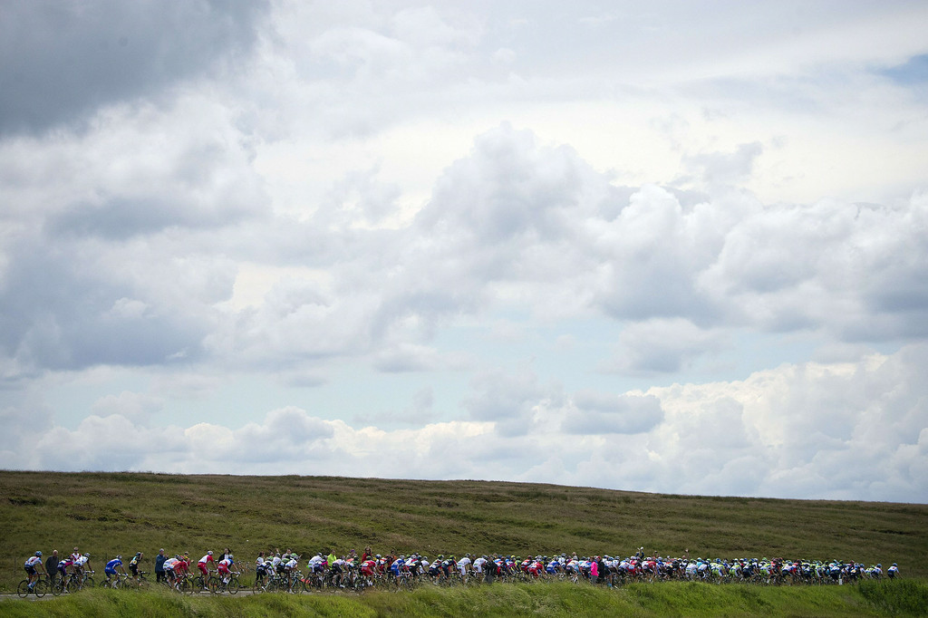 . The pack rides during the 201 km second stage of the 101th edition of the Tour de France cycling race on July 6, 2014 between York and Sheffield, northern England.  AFP PHOTO / JEFF PACHOUDJEFF PACHOUD/AFP/Getty Images
