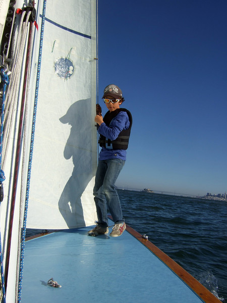 "Silas, Marc Lambros' son - Sailing on San Francisco Bay on Ron Young's classic wooden boat ""Youngster"""